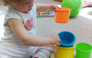 child sorting toys