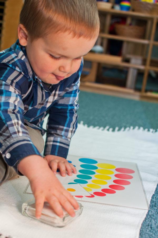 Boy working on sensorial work