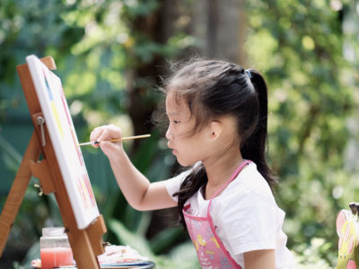 girl painting outdoors