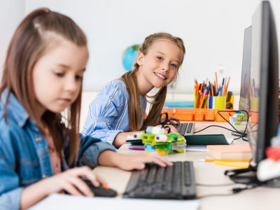 two girls working on computer and robotics